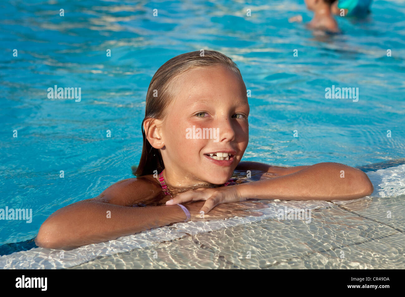 France, Corse du Sud, young girl at the swimming pool Stock Photo