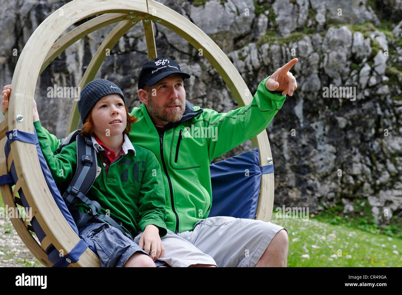 Father and son on the Gipfel-Erlebnisweg, summit adventure trail at Alpspitzbahn, Garmisch-Partenkirchen, Wetterstein - Stock Image