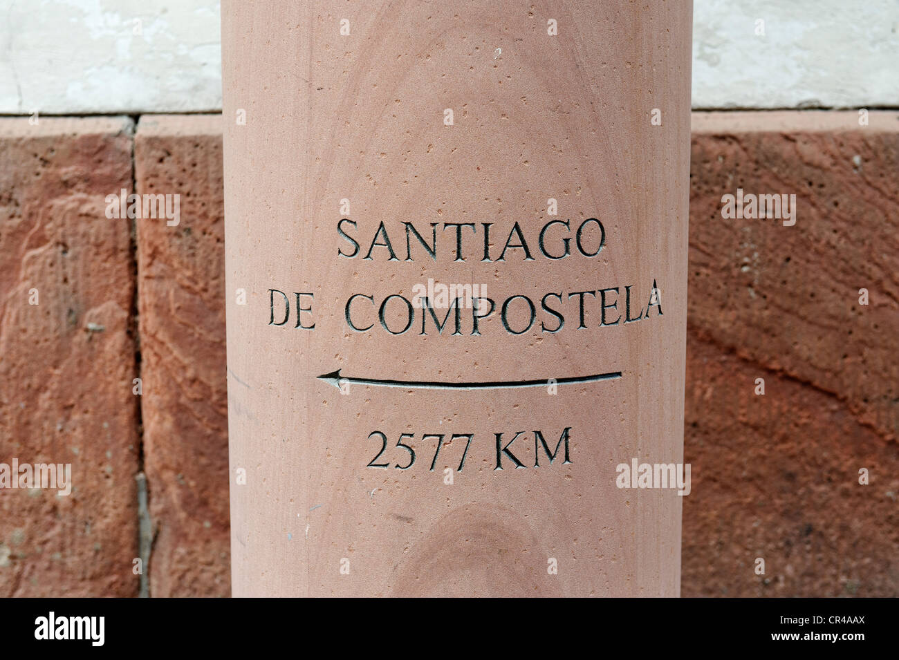 Column with lettering for the Camino de Santiago, Way of St. James, pilgrimage road to Santiago de Compostela, Miltenberg - Stock Image