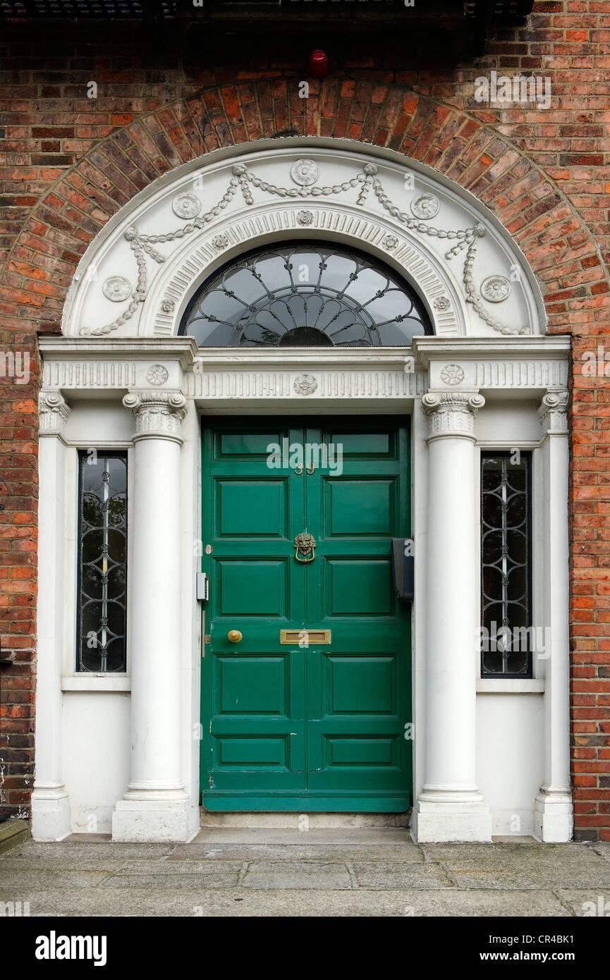 Green front door of a terraced house near Merrion Park, Dublin, Republic of Ireland, Europe Stock Photo