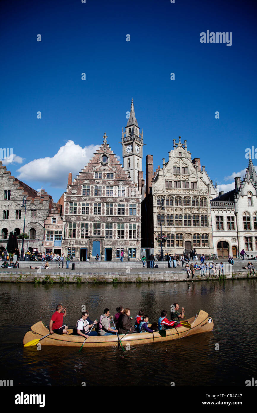 Guild houses and boat on Leie River, Ghent, Western Flanders, Belgium, Europe - Stock Image