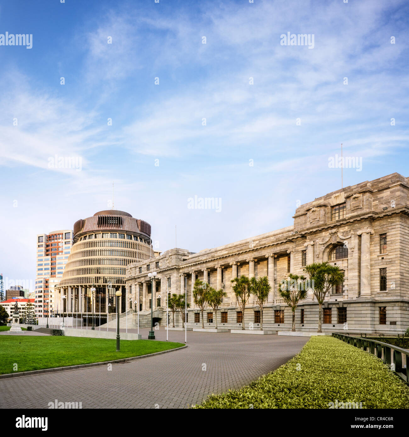 The Beehive, which is the executive offices of New Zealand's Parliament, and Parliament House. - Stock Image