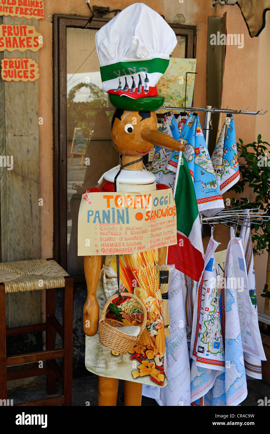 Pinocchio as a promotional figure in front of a restaurant in the Via Santa Maria, Pisa, Tuscany, Italy, Europe - Stock Image