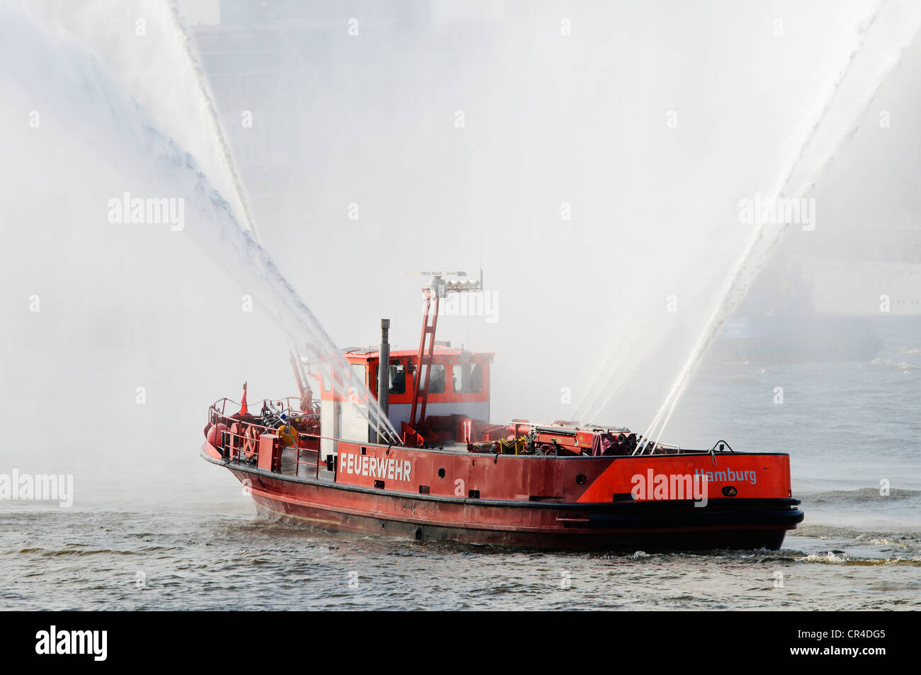 Fire boat of the Hamburg Fire Department displaying water cannon during the harbour anniversary celebrations in - Stock Image