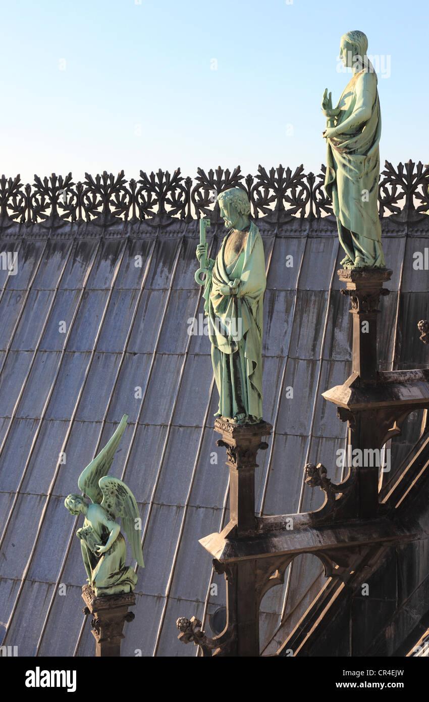 France, Paris, Ile de la Cite, Notre Dame de Paris cathedral, the apostles statues at the base of the arrow - Stock Image