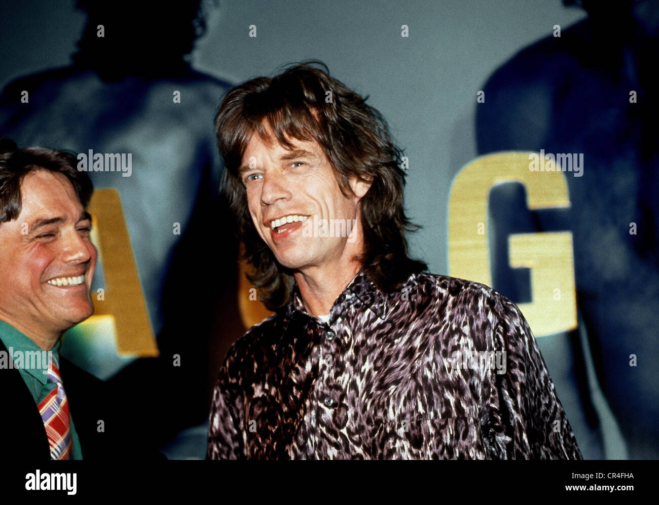 Jagger, Mick, * 26.7.1943, British musician, portrait, receiving the Golden Record for 'Wandering Spirit', - Stock Image