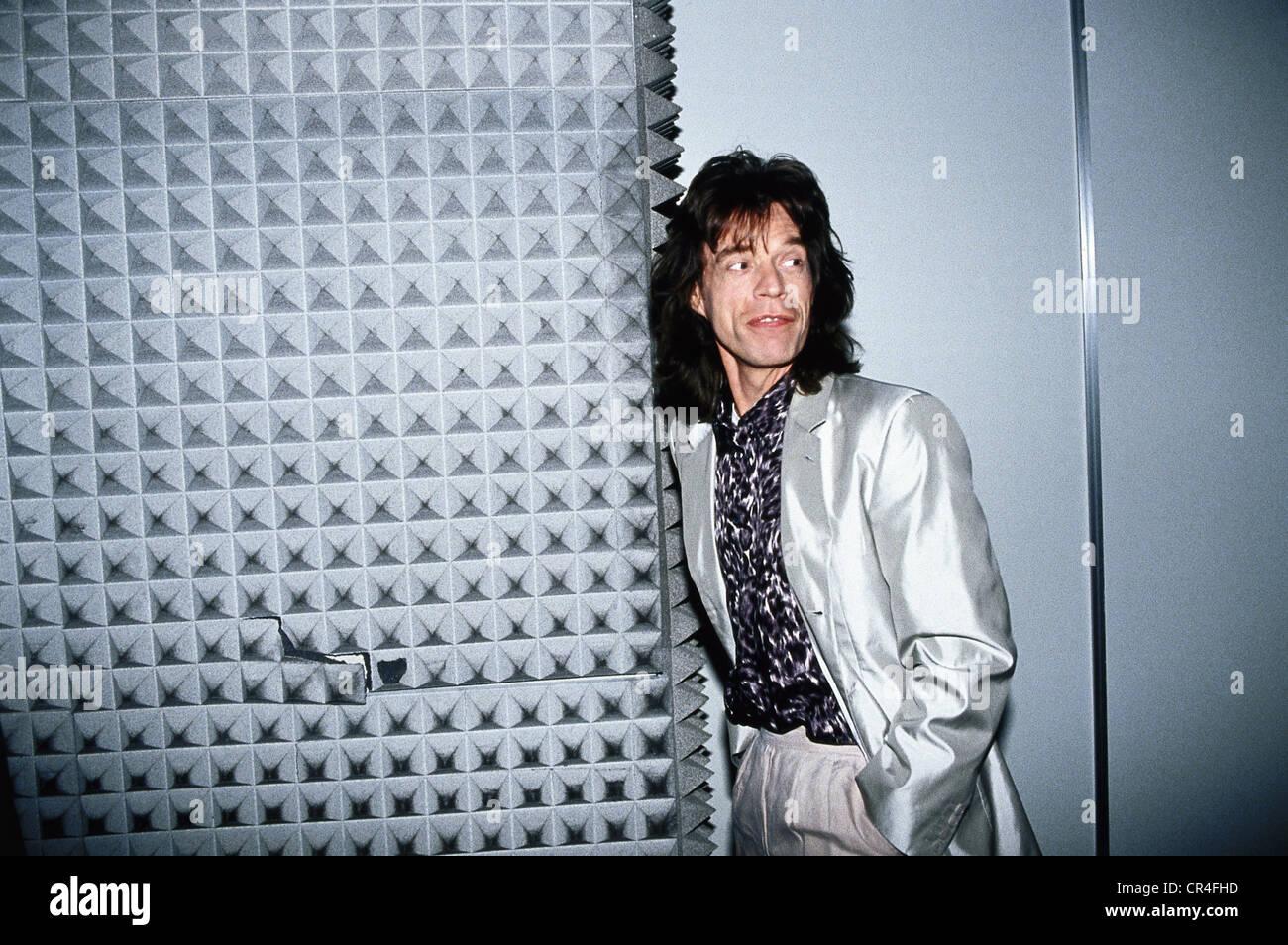 Jagger, Mick, * 26.7.1943, British musician, half length, receiving the Golden Record for 'Wandering Spirit', - Stock Image