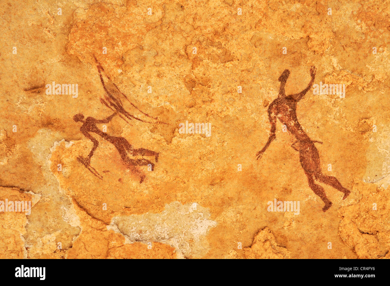 Painted warriors or hunters, neolithic rock art at Tin Meskis, Adrar n'Ahnet, Algeria, Sahara, North Africa Stock Photo