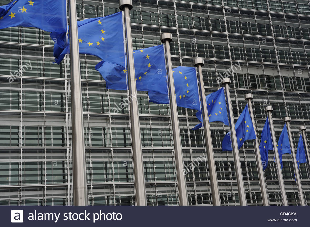 Brussels Belgium European flags flying in front of the Berlymont building, the head offices of the European Commission. - Stock Image