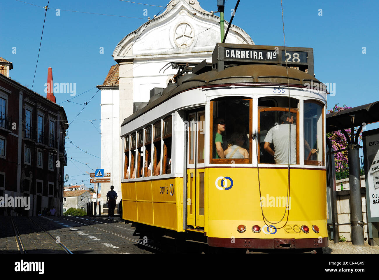 Portugal, Lisbon, Alfama District, passing of tramway along the la rua do Limoeiro in front of the Santa Luzia Church Stock Photo