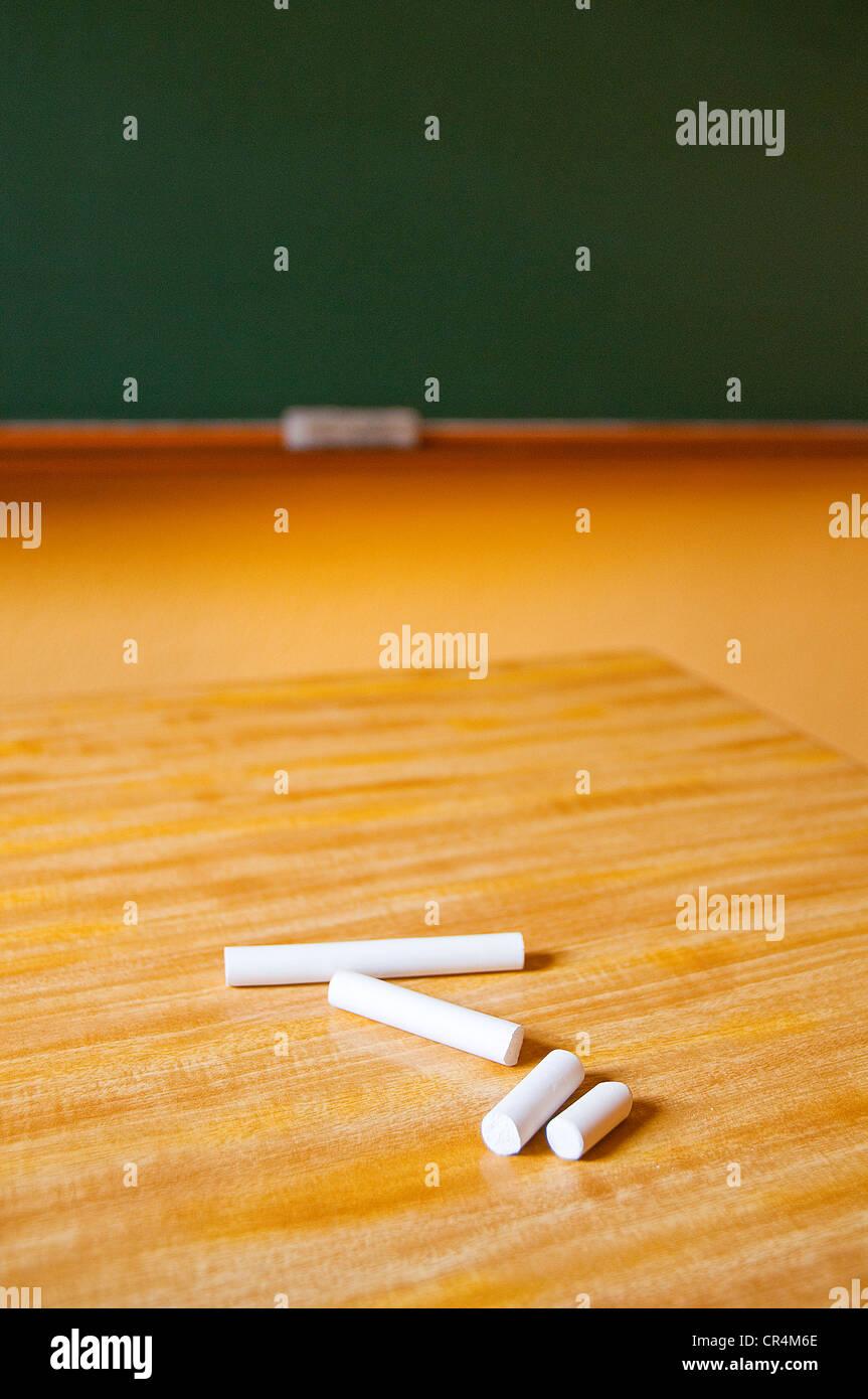 Chalks on teacher's table. Stock Photo