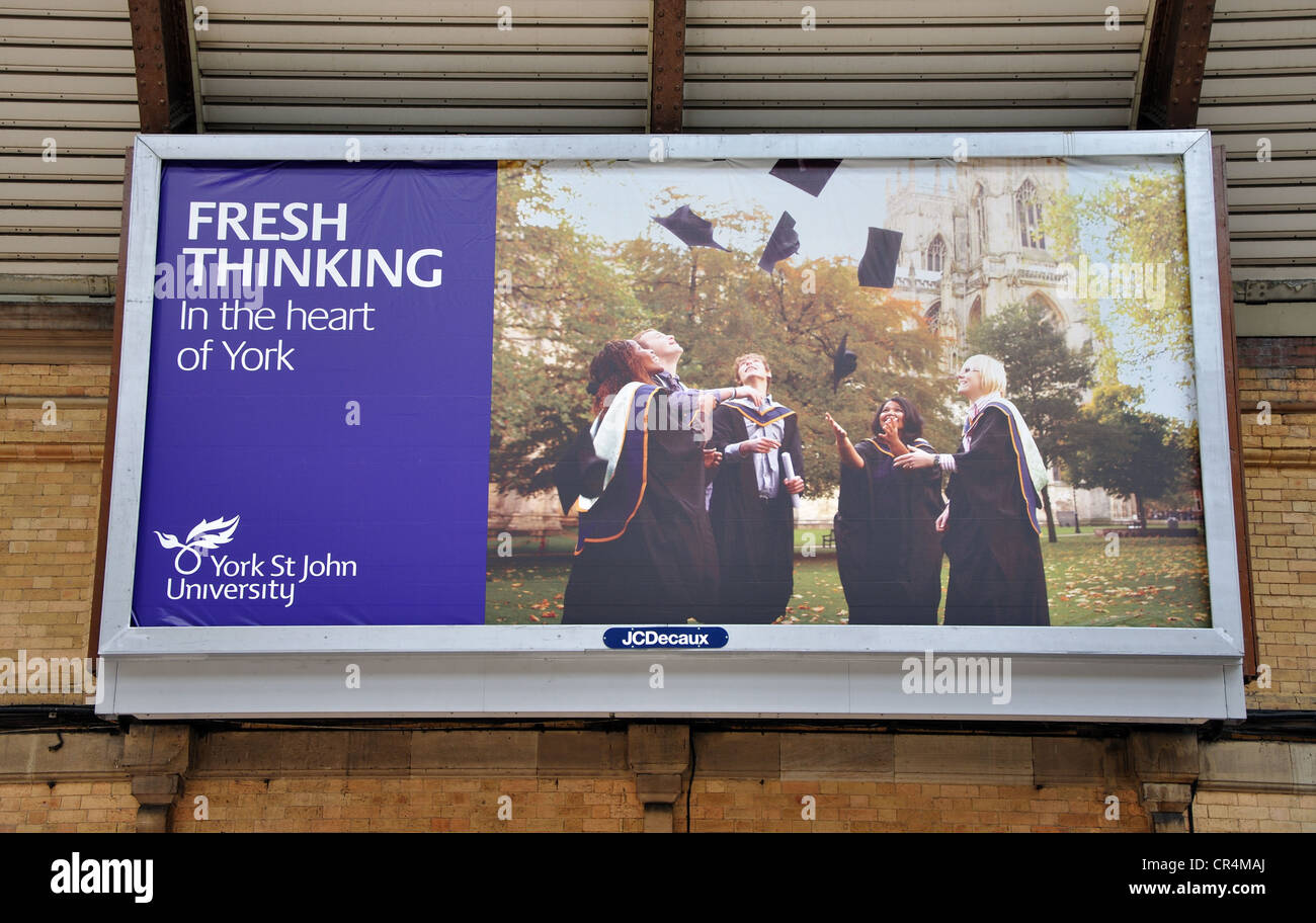 billboard on the wall of York railway station advertising York St John University, York, North Yorkshire, England, - Stock Image