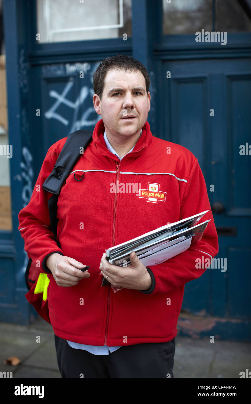 The Great British Postman. Postal worker on the streets of UK. - Stock Image