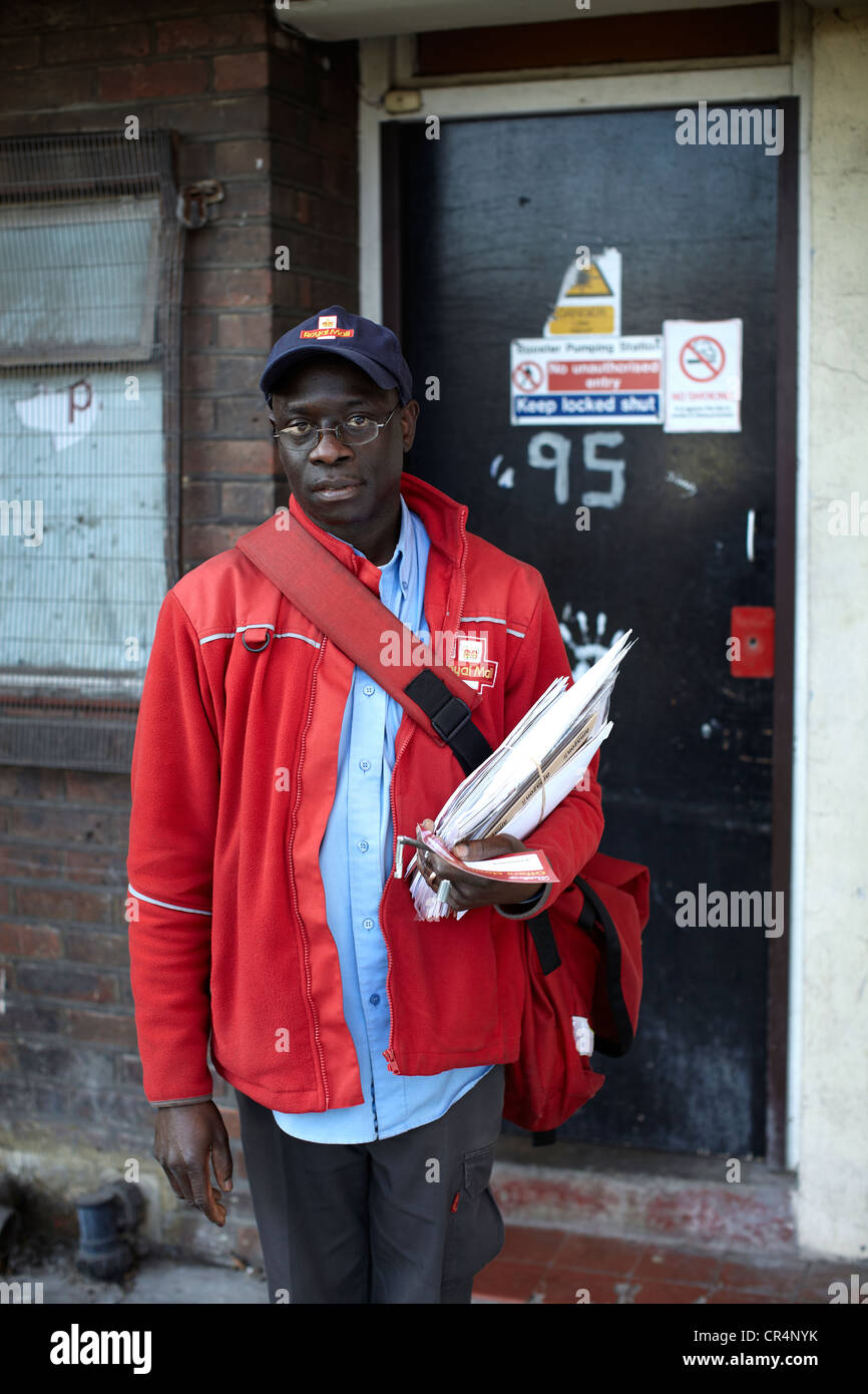 The Great British Postman Postal Worker On The Streets Of Uk