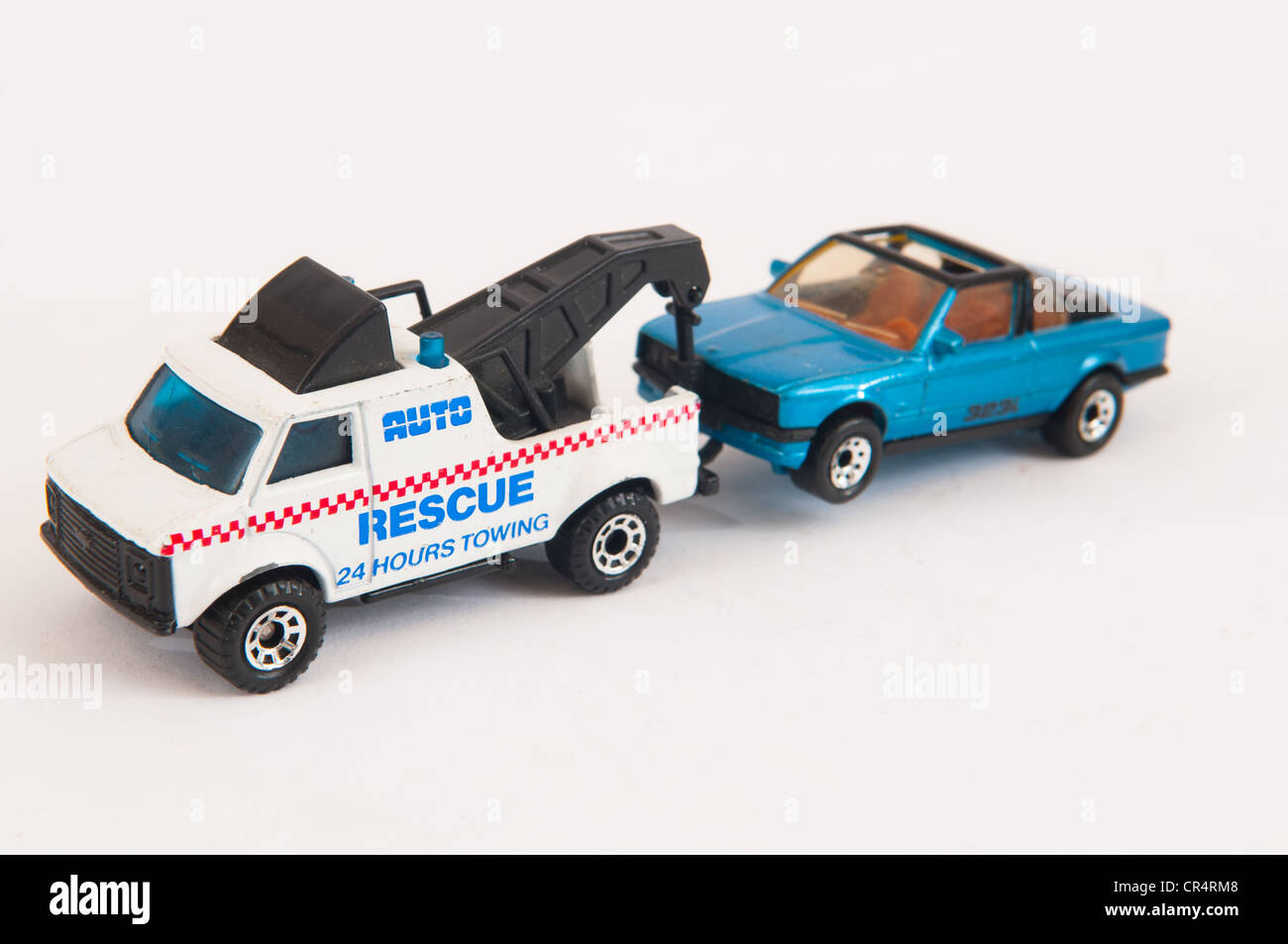 Child's toy rescue truck and car - Stock Image