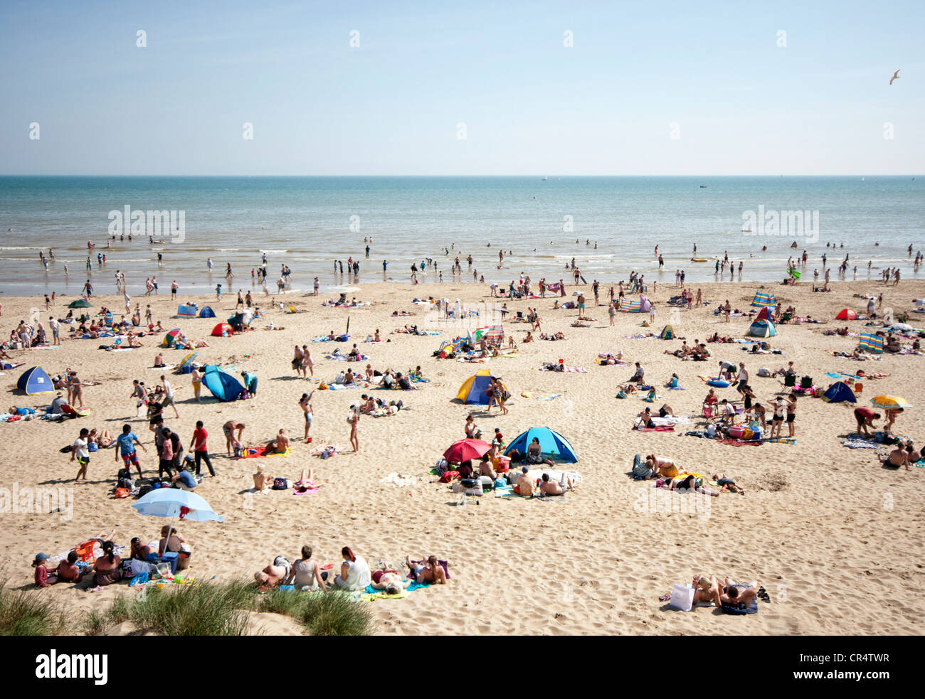 aerial view onto Camber Sands beach on a busy , sunny weekend in summer showing people using the beach and sea with - Stock Image