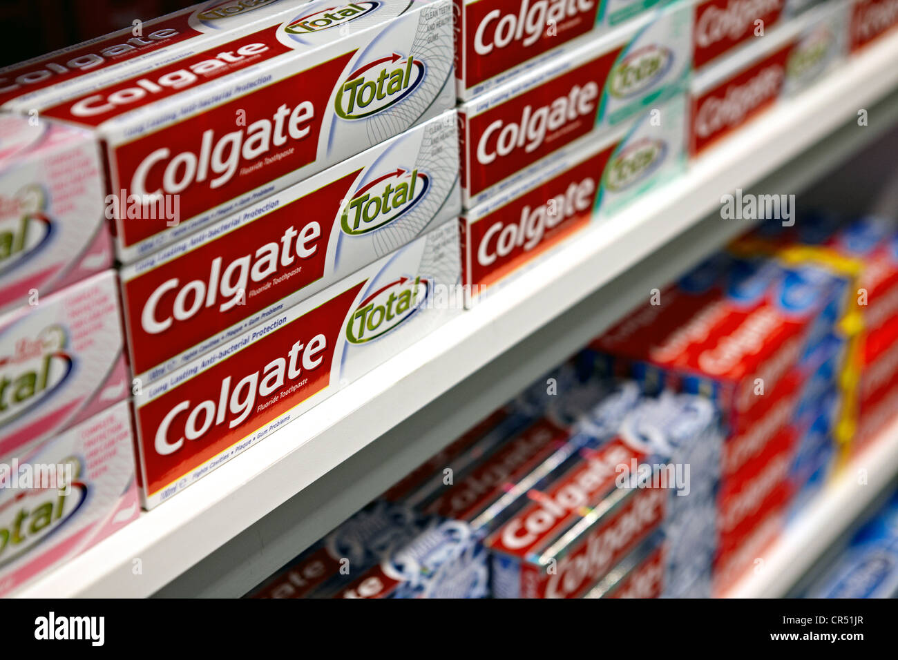 Colgate total toothpaste pictured on a supermarket shelf. Manufactured by Colgate-Palmolive - Stock Image