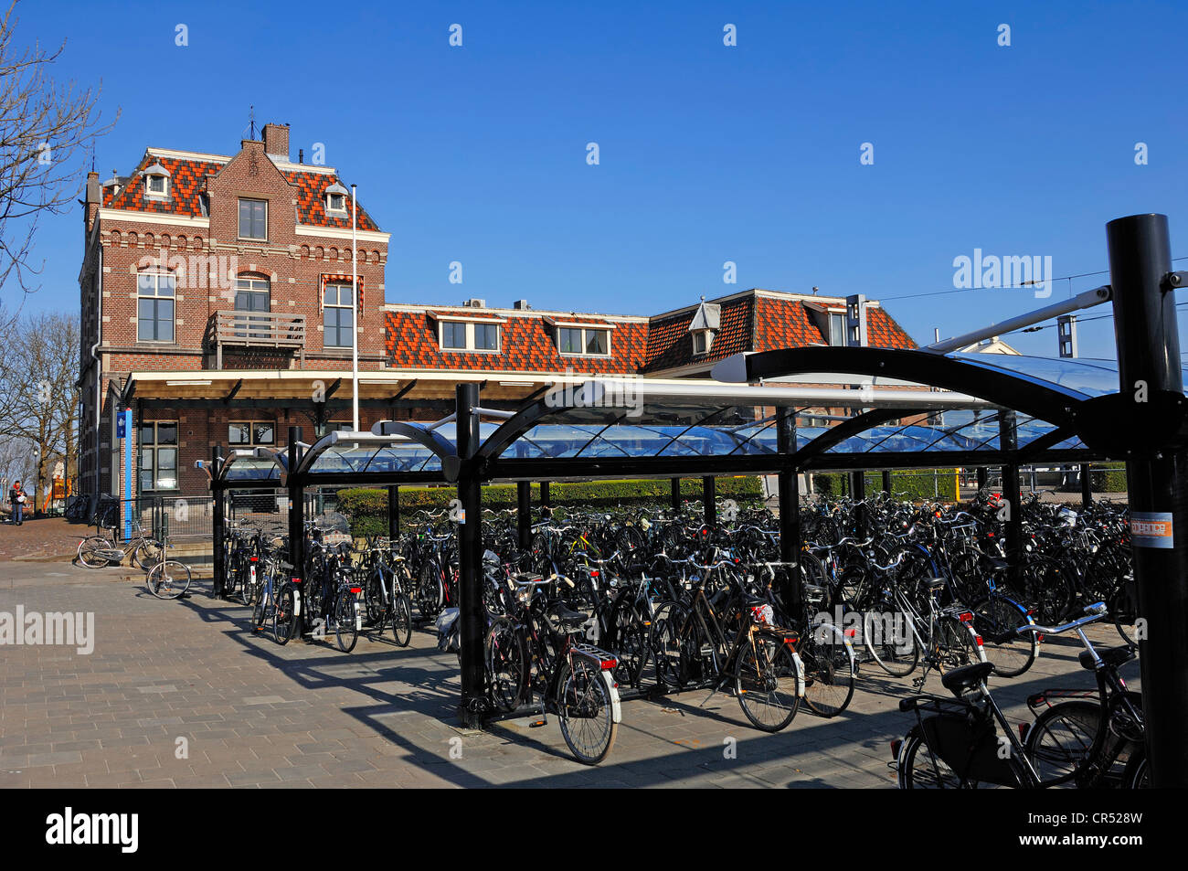 Bicycles parked at the railway station in Enkhuizen, North Holland, Holland, Netherlands, Europe - Stock Image