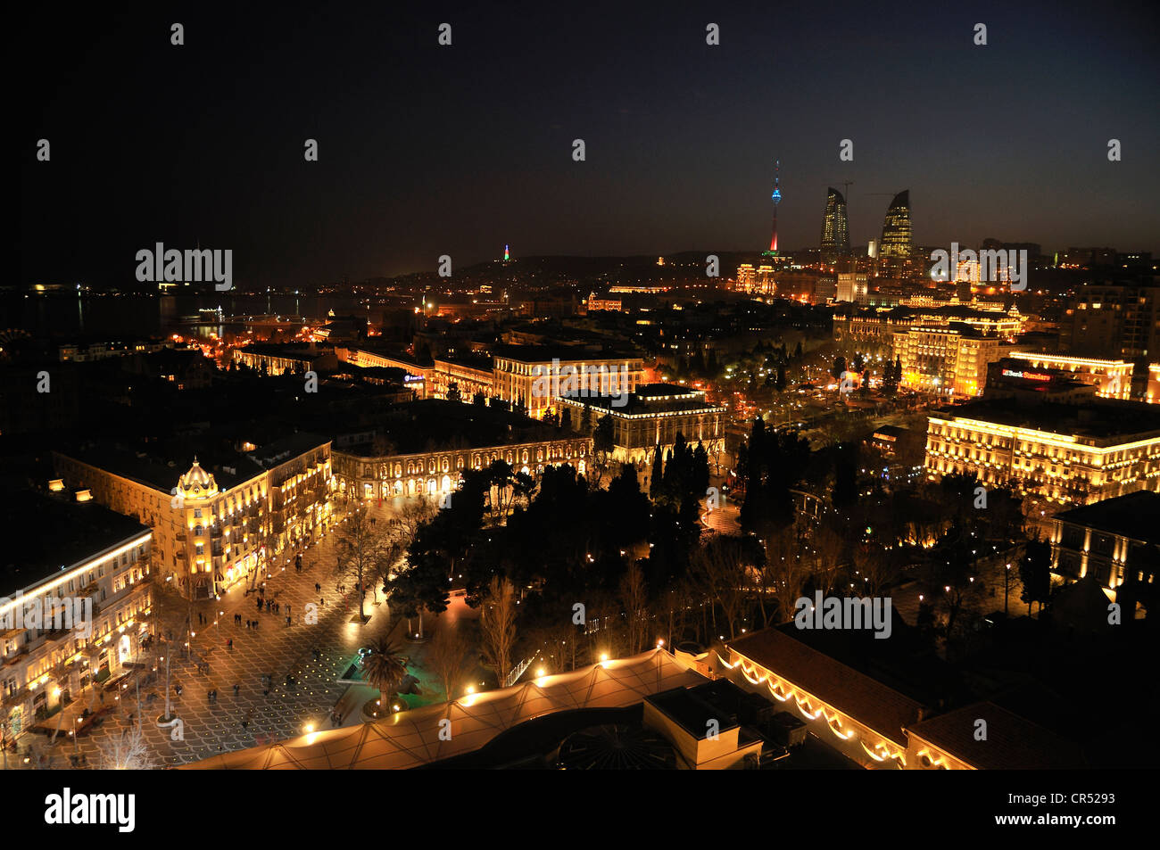 Historic city centre of Baku, dusk, UNESCO World Heritage Site, with the high-rise towers of the three Flame Towers - Stock Image