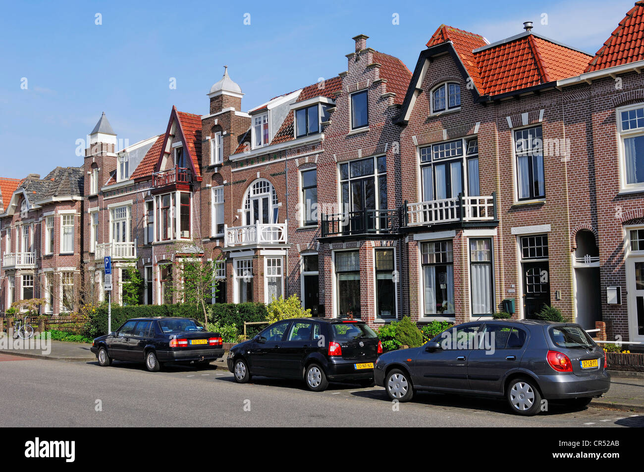 Parked cars in front of a row of houses, Alkmaar, North Holland, Holland, Netherlands, Europe - Stock Image