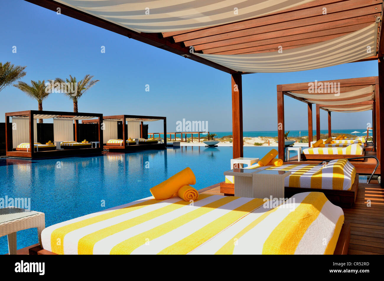 swimming pool of the monte carlo beach club on saadiyat island abu stock photo 48669809 alamy. Black Bedroom Furniture Sets. Home Design Ideas
