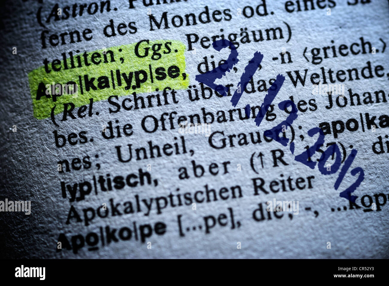 The word apocalypse highlighted in a dictionary and the date 21.12.2012, symbolic image for the doomsday prophecy - Stock Image