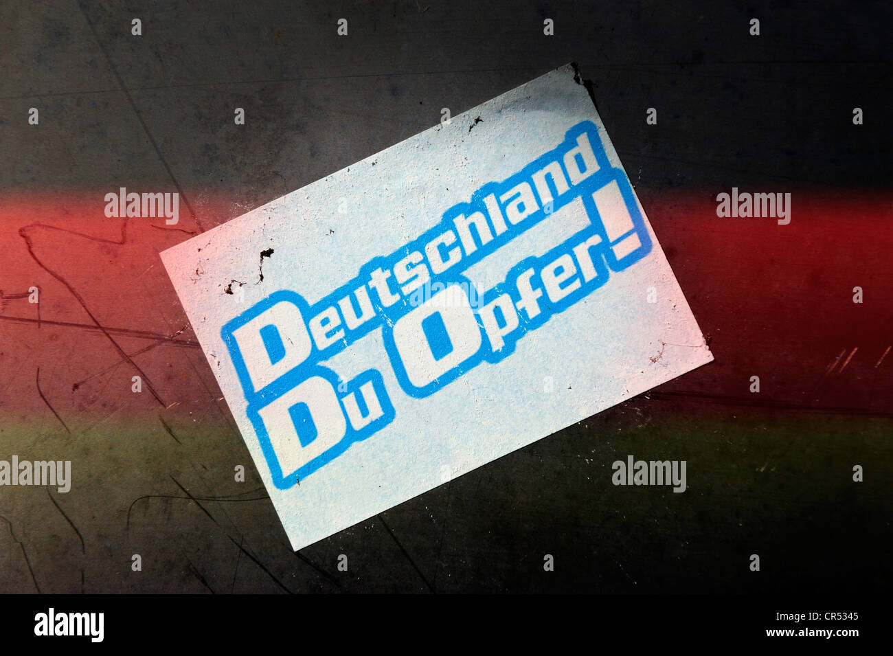 Sticker on a wall, 'Deutschland, Du Opfer!', German for 'Germany, you are a victim' - Stock Image