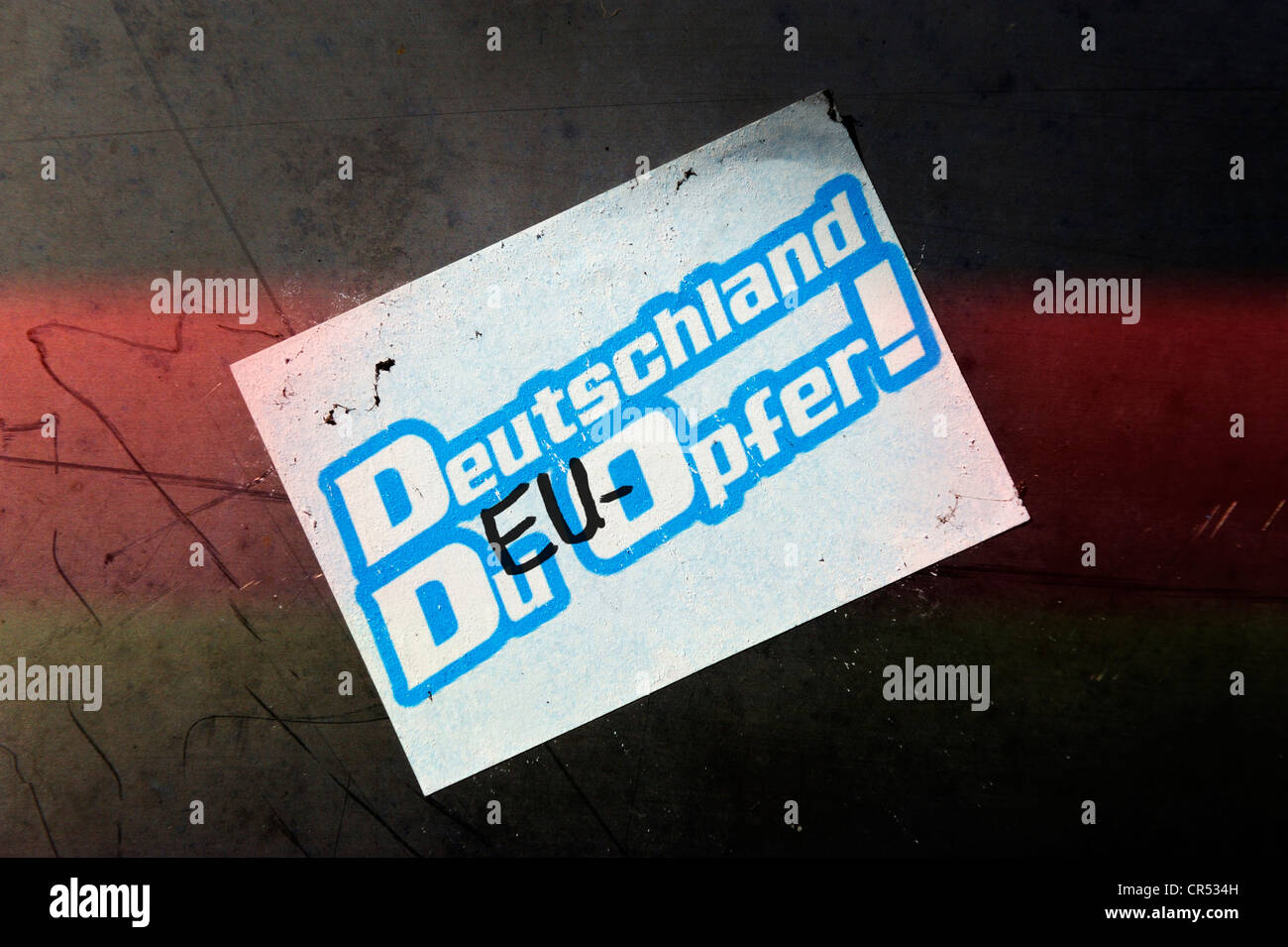 Sticker on a wall, 'Deutschland, Du EU-Opfer!', German for 'Germany, you are a EU victim' - Stock Image