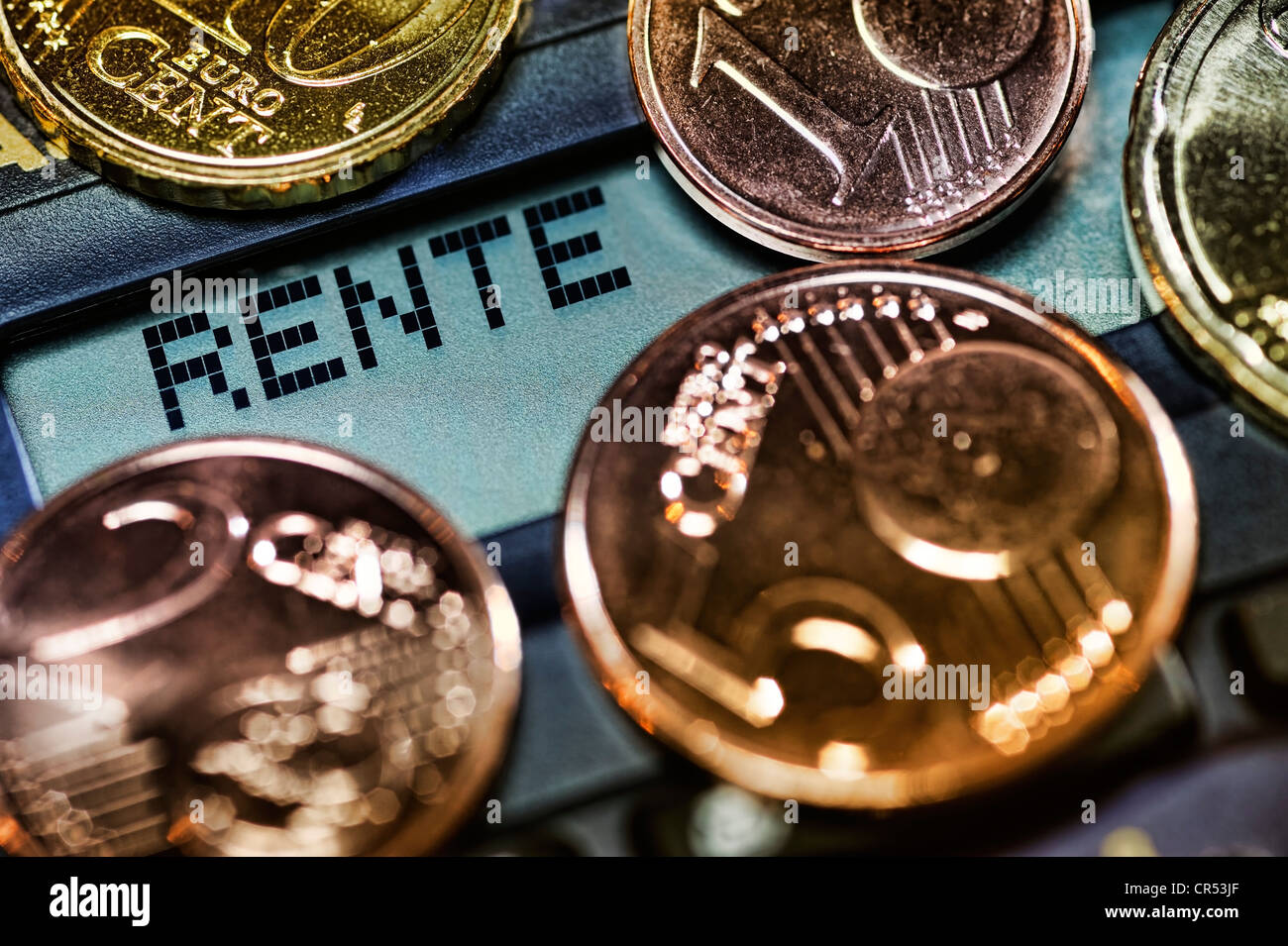 Lettering 'Rente', German for 'pension' on a calculator and coins, symbolic image for low pensions - Stock Image
