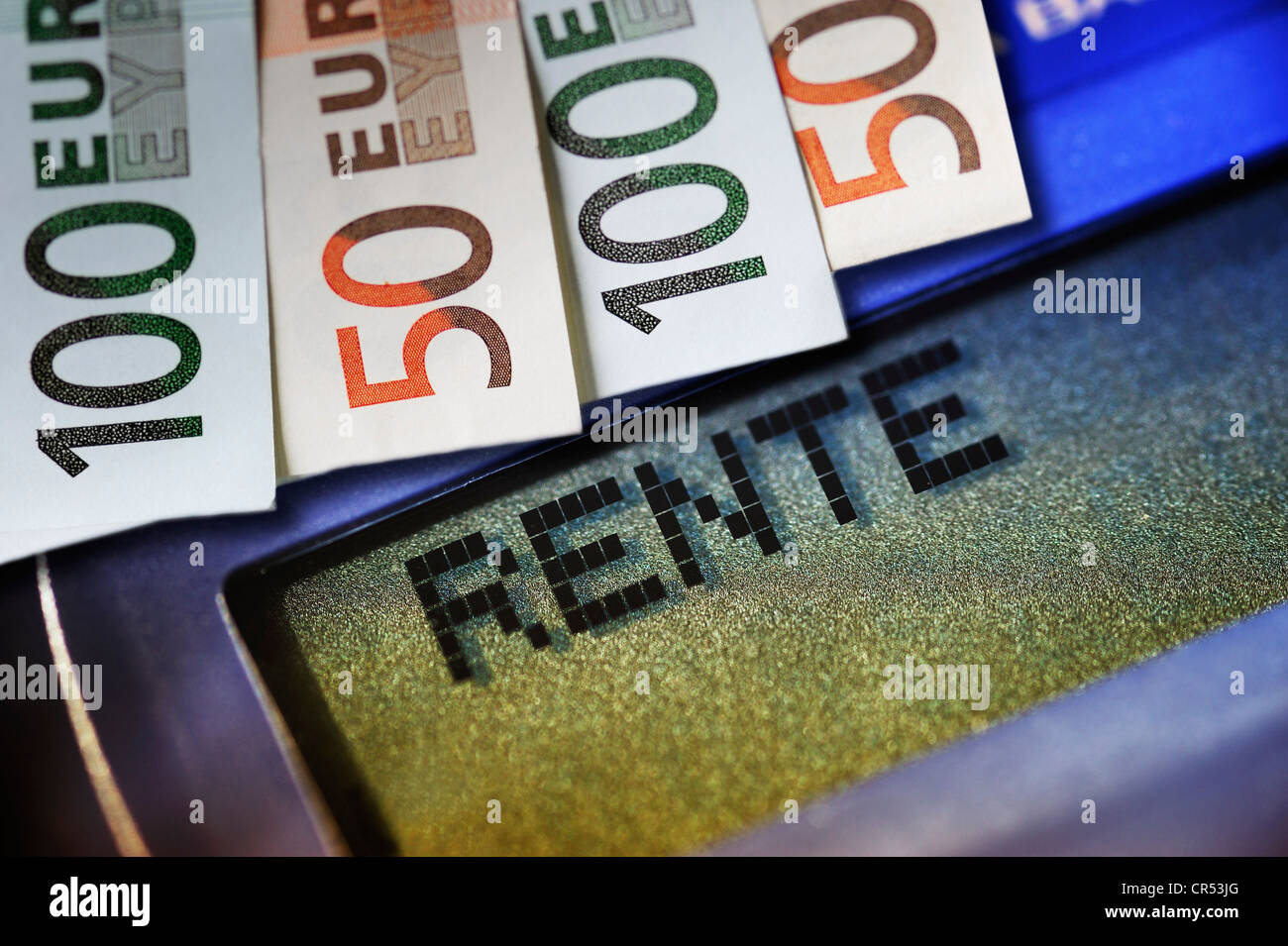 Lettering 'Rente', German for 'pension', on a calculator and banknotes, symbolic image - Stock Image