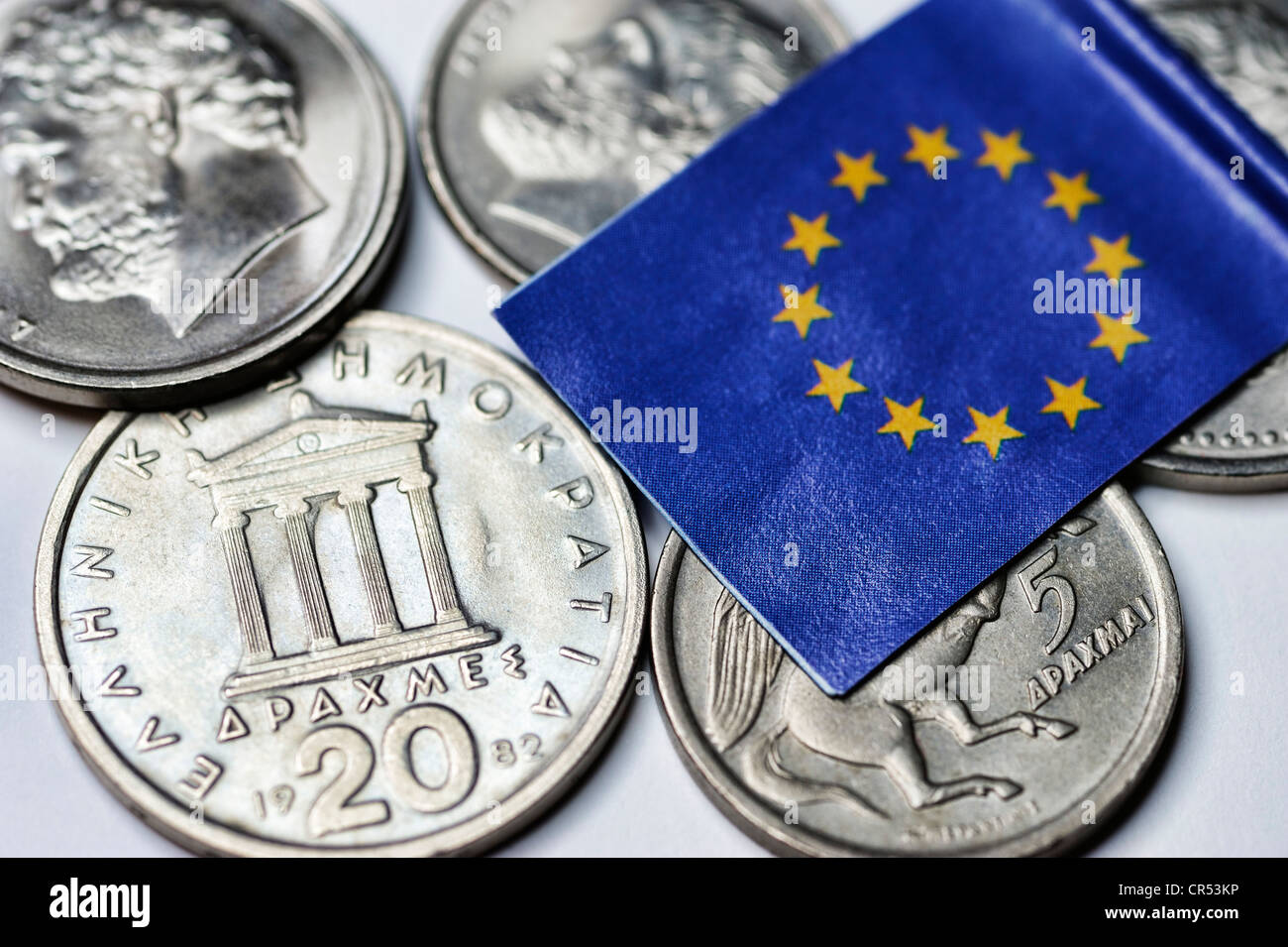 Greek drachmas with the EU flag, symbolic image of the possible discontinuation of the euro in Greece - Stock Image