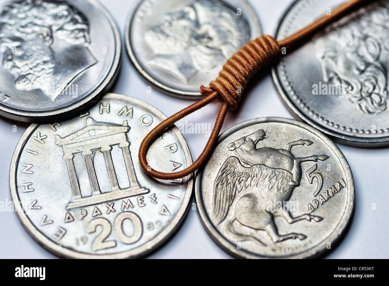 Greek drachmas with a hangman's noose, symbolic image of the possible discontinuation of the euro in Greece - Stock Image