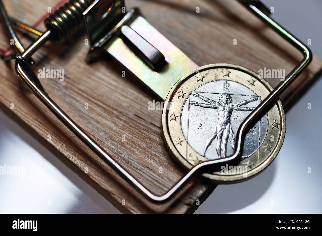 Italian one-euro coin into the debt trap, symbolic image - Stock Image
