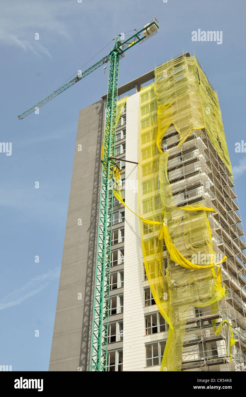 Vacant high-rise with crane, housing crisis, Calpe, Costa Blanca, Spain, Europe - Stock Image