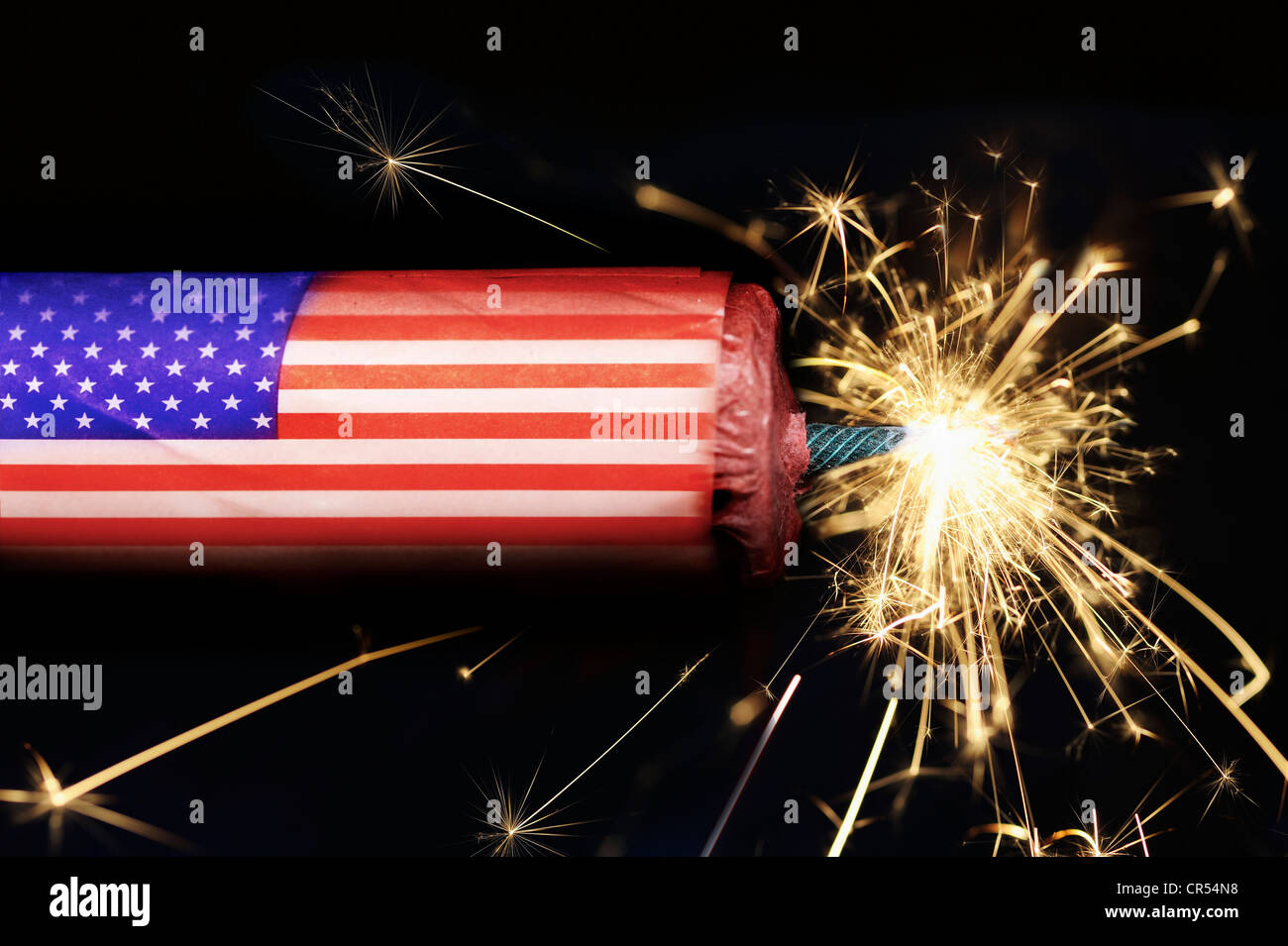 Stick of dynamite with a flag of U.S.A. with a burning fuse, symbolic image of the U.S. national debt - Stock Image
