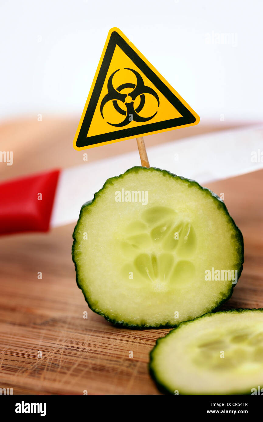 Sliced cucumber with bio-hazard symbol, symbolic image for EHEC pathogens Stock Photo