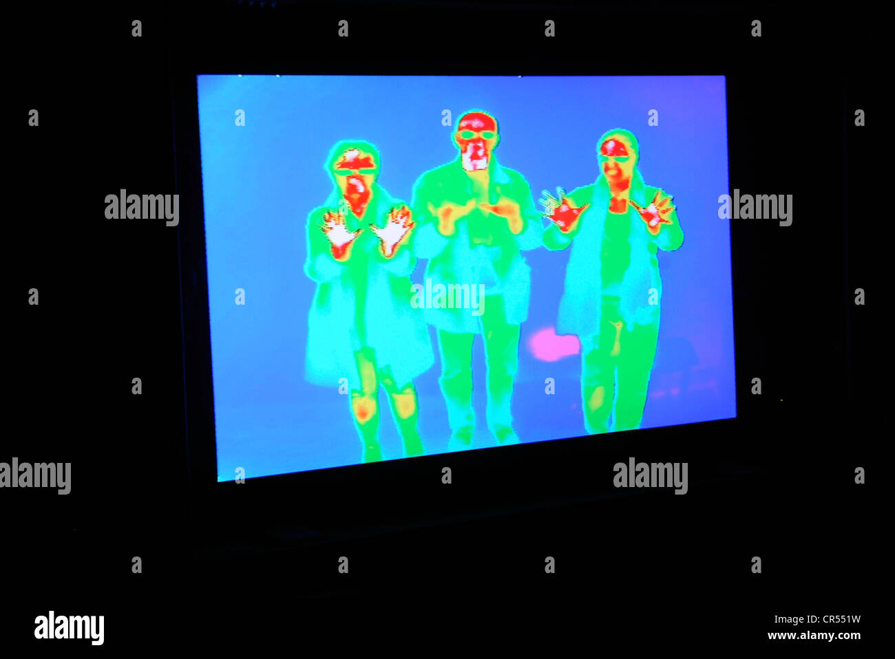 Thermographic image registers infrared heat signature.  Hotter areas appear red, cooler blue. - Stock Image