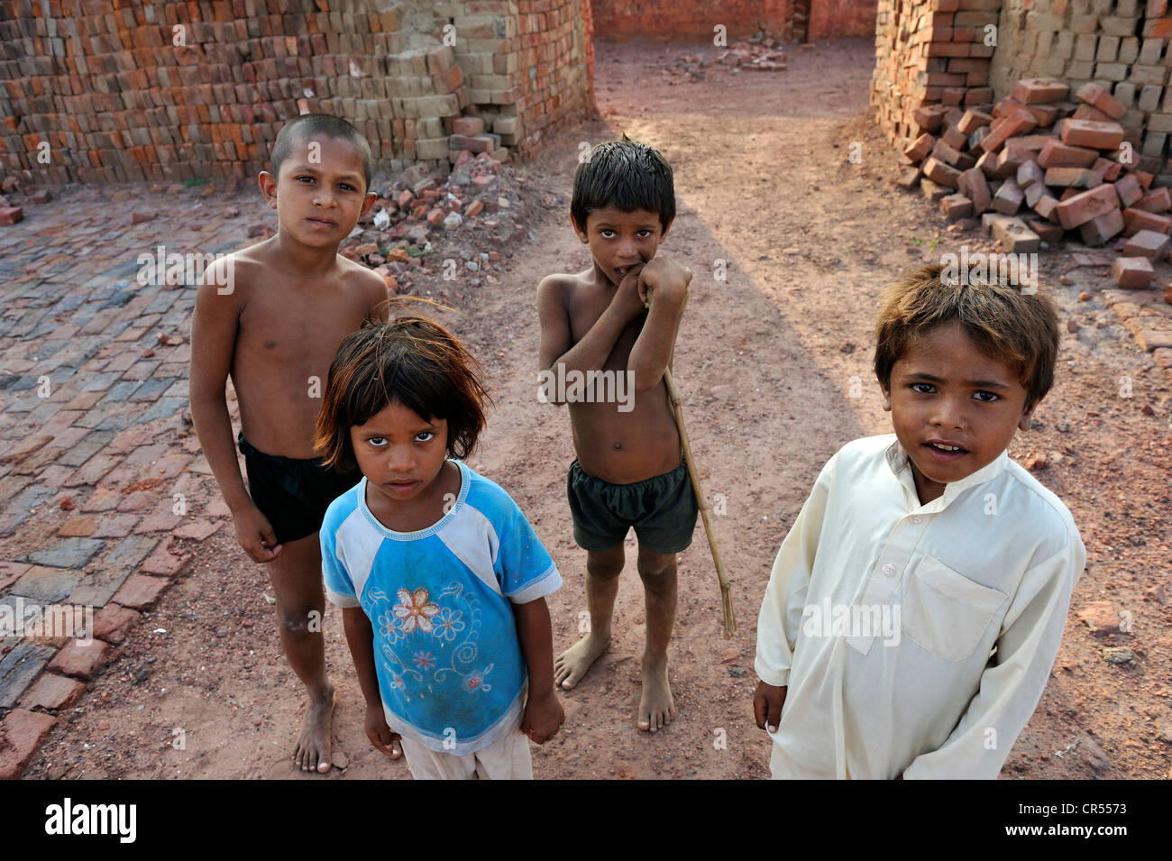 Children who live with their families under the slavery-like practice of debt bondage in a brick factory, Lahore, - Stock Image