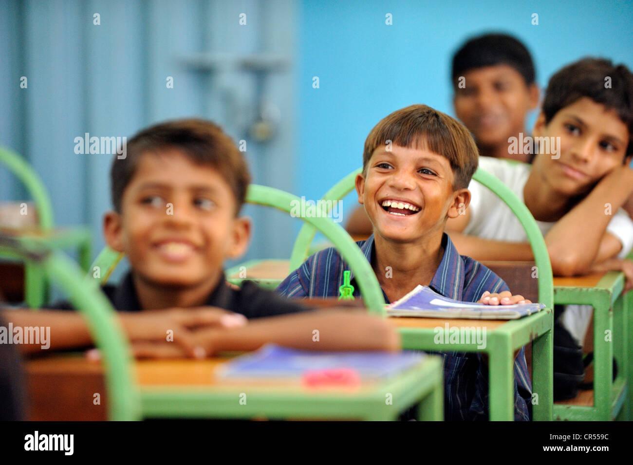 Pakistani boys seating at their school desks, Lahore, Punjab, Pakistan, Asia - Stock Image