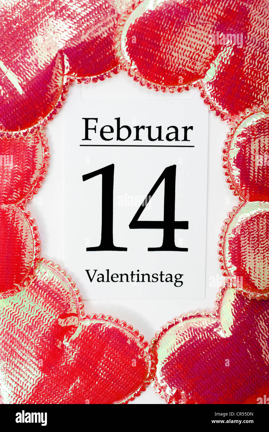Calendar sheet for Valentine's Day on 14 February, red hearts - Stock Image