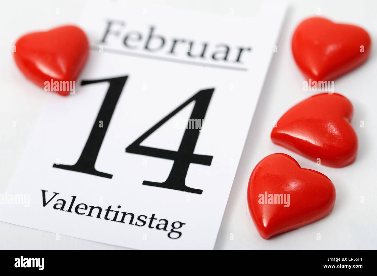 Calendar sheet for Valentine's Day on 14 February with red hearts - Stock Image