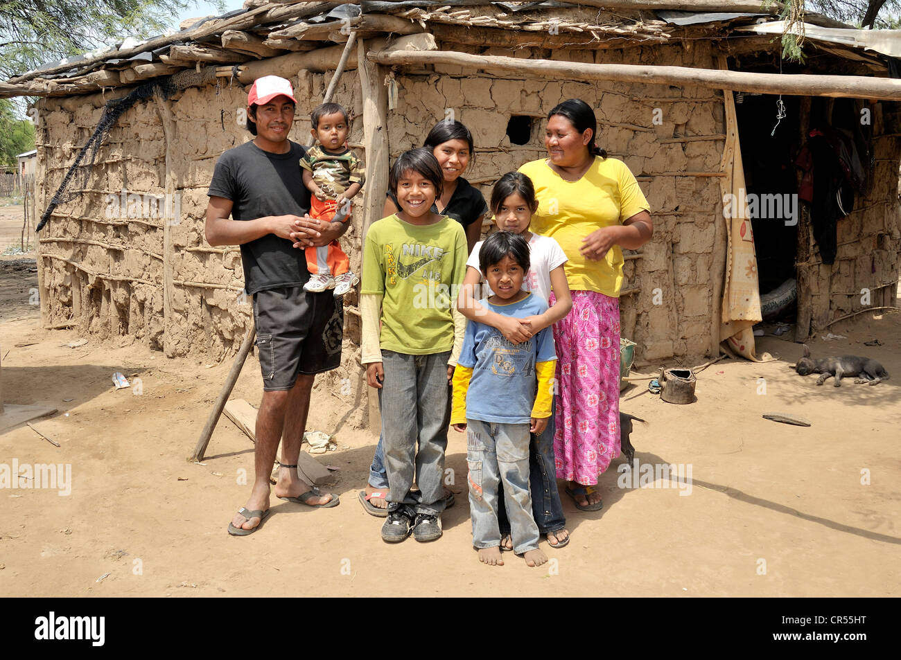 Family from the Wichi Indians tribe in front of their mud-brick hut, Comunidad Santa Maria, Gran Chaco,  province, - Stock Image