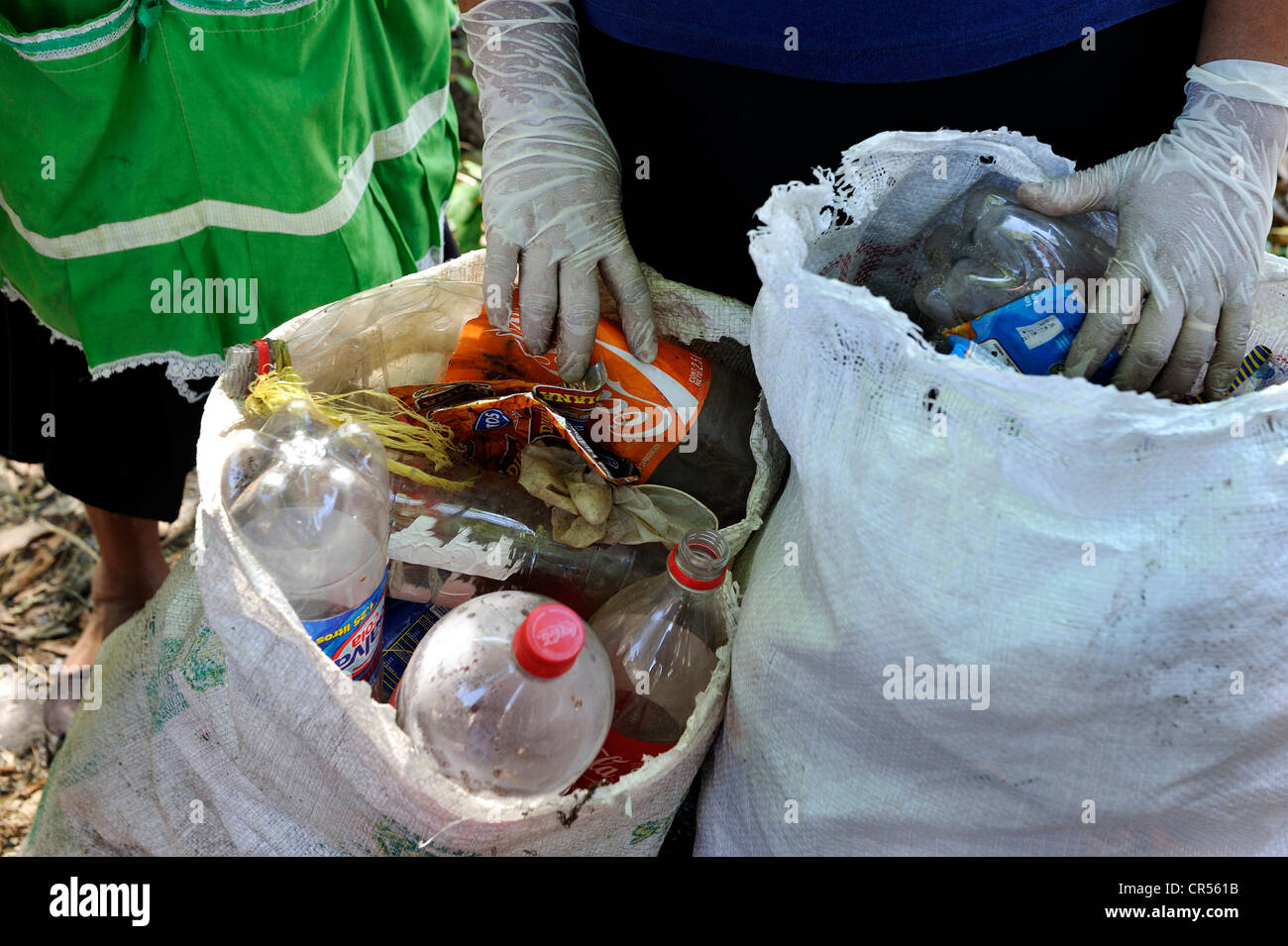 Rubbish bags full of rubbish collected by women in a clean-up operation organised by the Swiss Red Cross, the rubbish - Stock Image