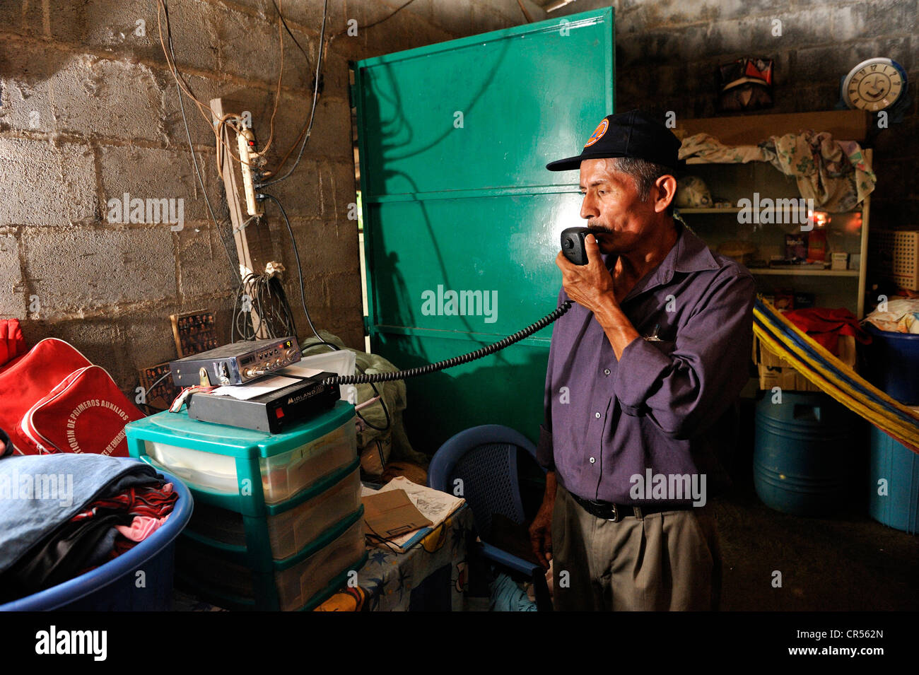 Jose Domingo Cruz, 55 years, was trained by the Red Cross as a radio operator to be be able to maintain contact - Stock Image
