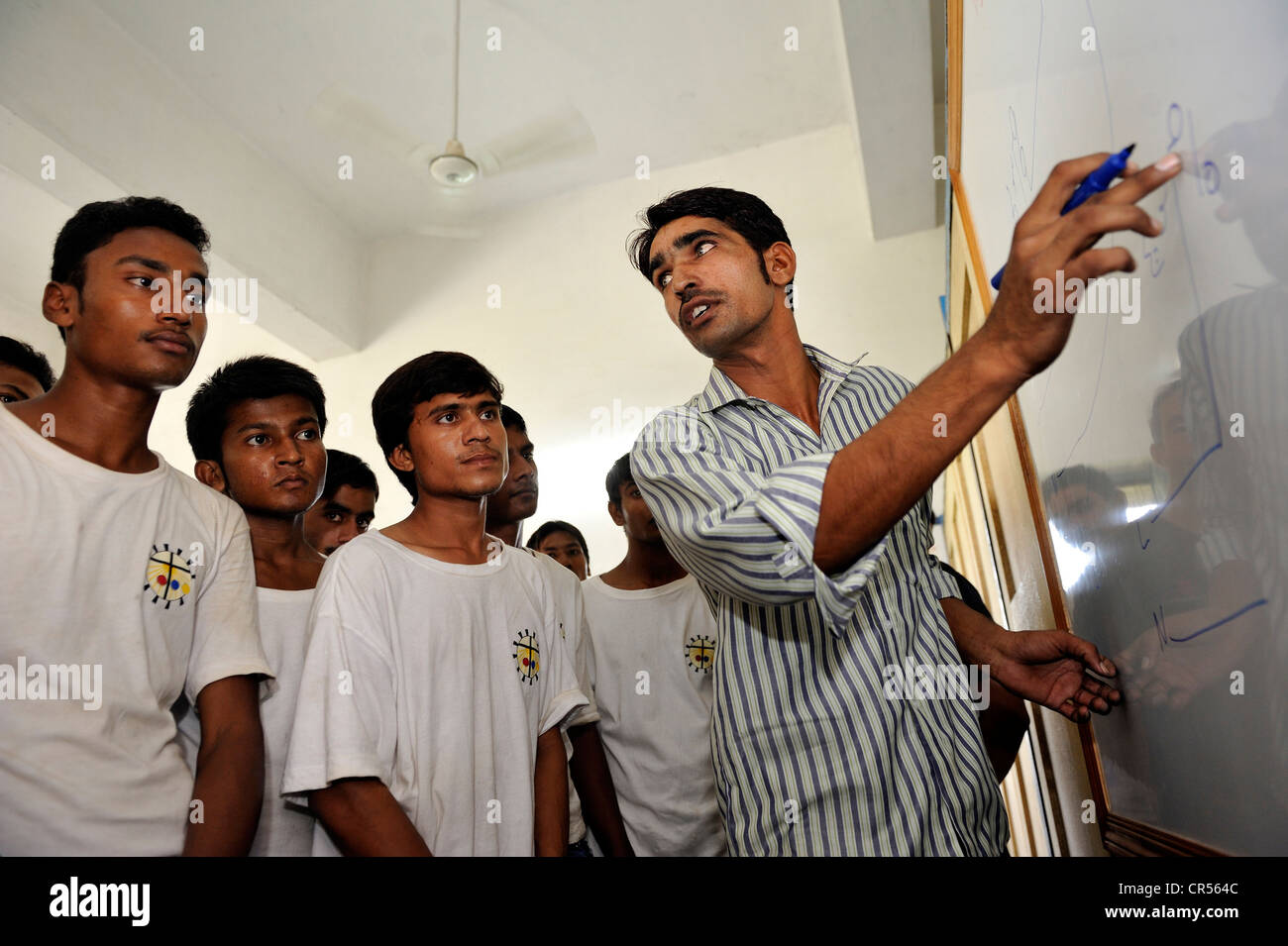 Vocational training as electricians at the Don Bosco Technical Centre DBTC, teacher standing at a whiteboard with - Stock Image