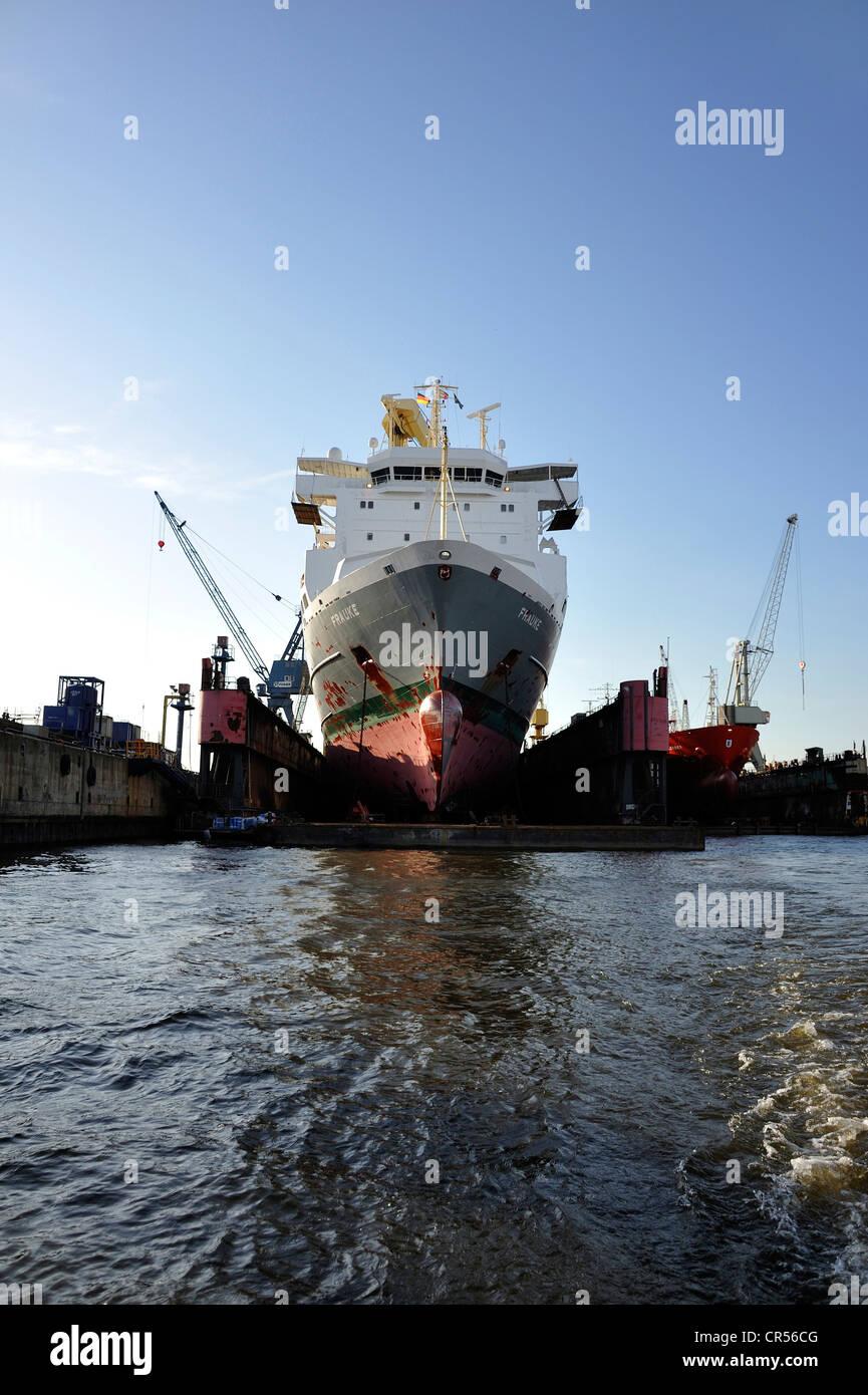 Cargo ship in a dry dock of the Port of Hamburg, Hanseatic City of Hamburg, Germany, Europe - Stock Image