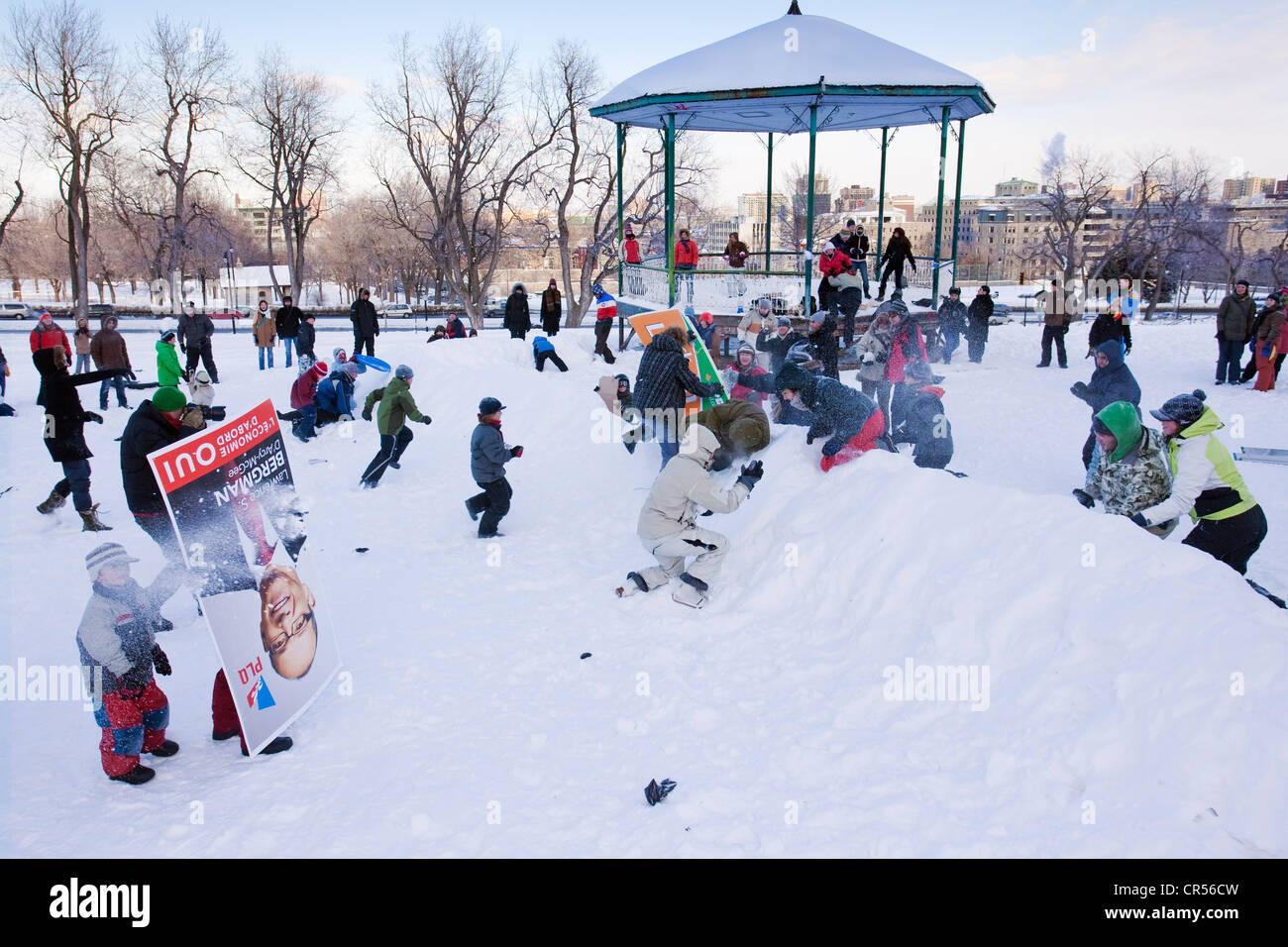 Canada, Quebec Province, Montreal, snowball battle between children and adults at the bottom of Mont Royal - Stock Image