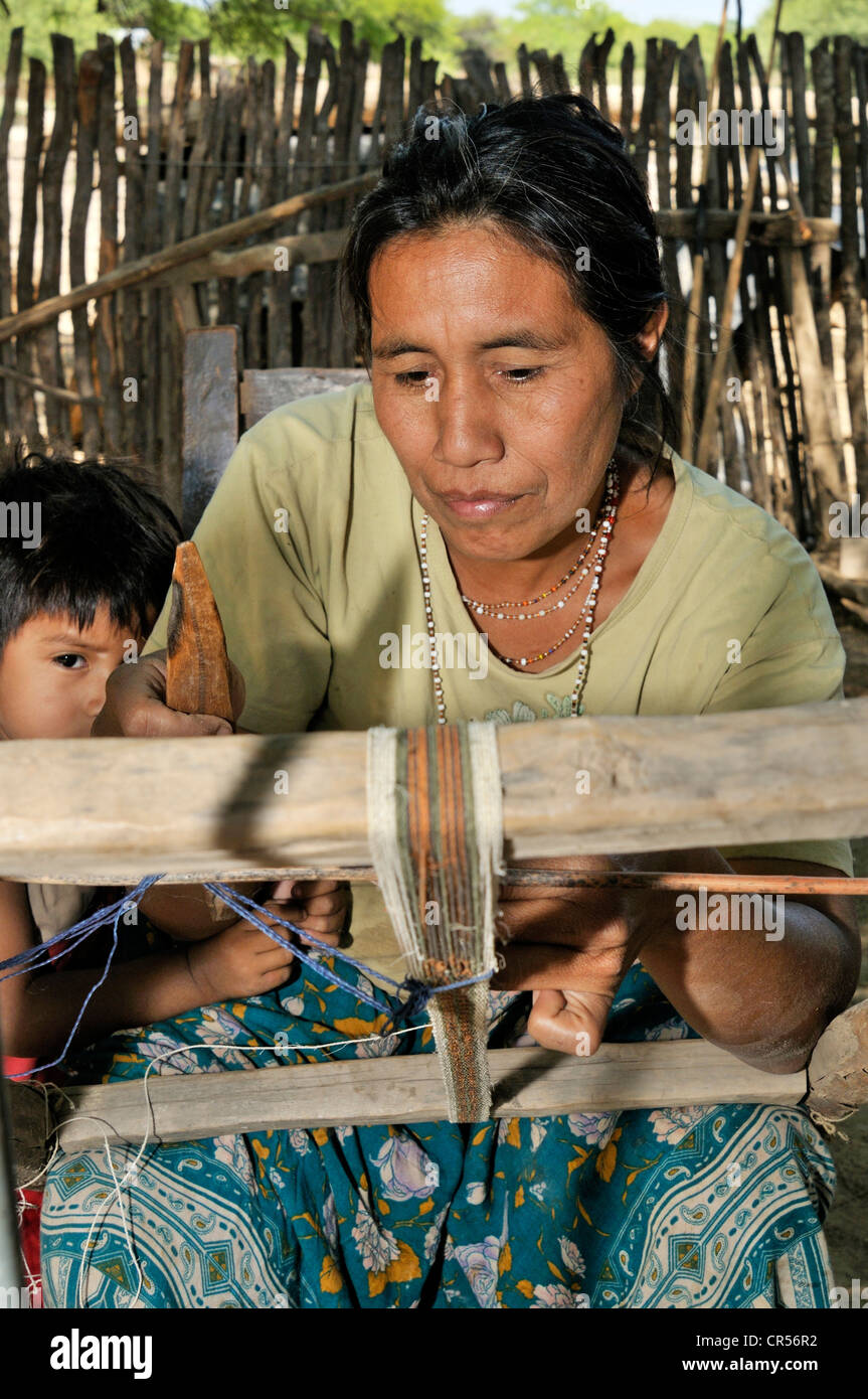 Traditional arts and crafts, woman weaving a ribbon from fibers of chaguar plants, indigenous community of Santa Stock Photo