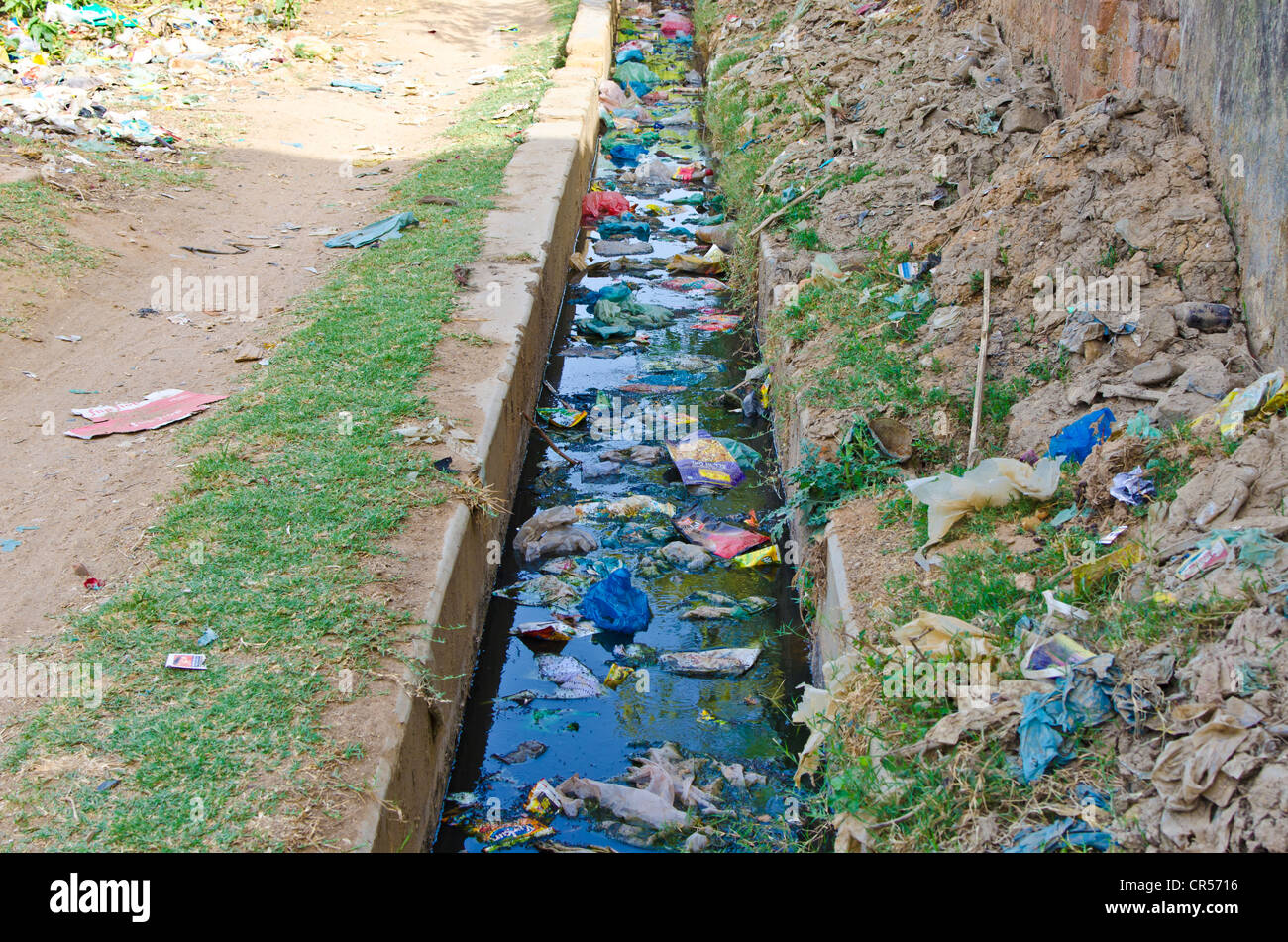 Sewage water polluted by plastic bags - Stock Image