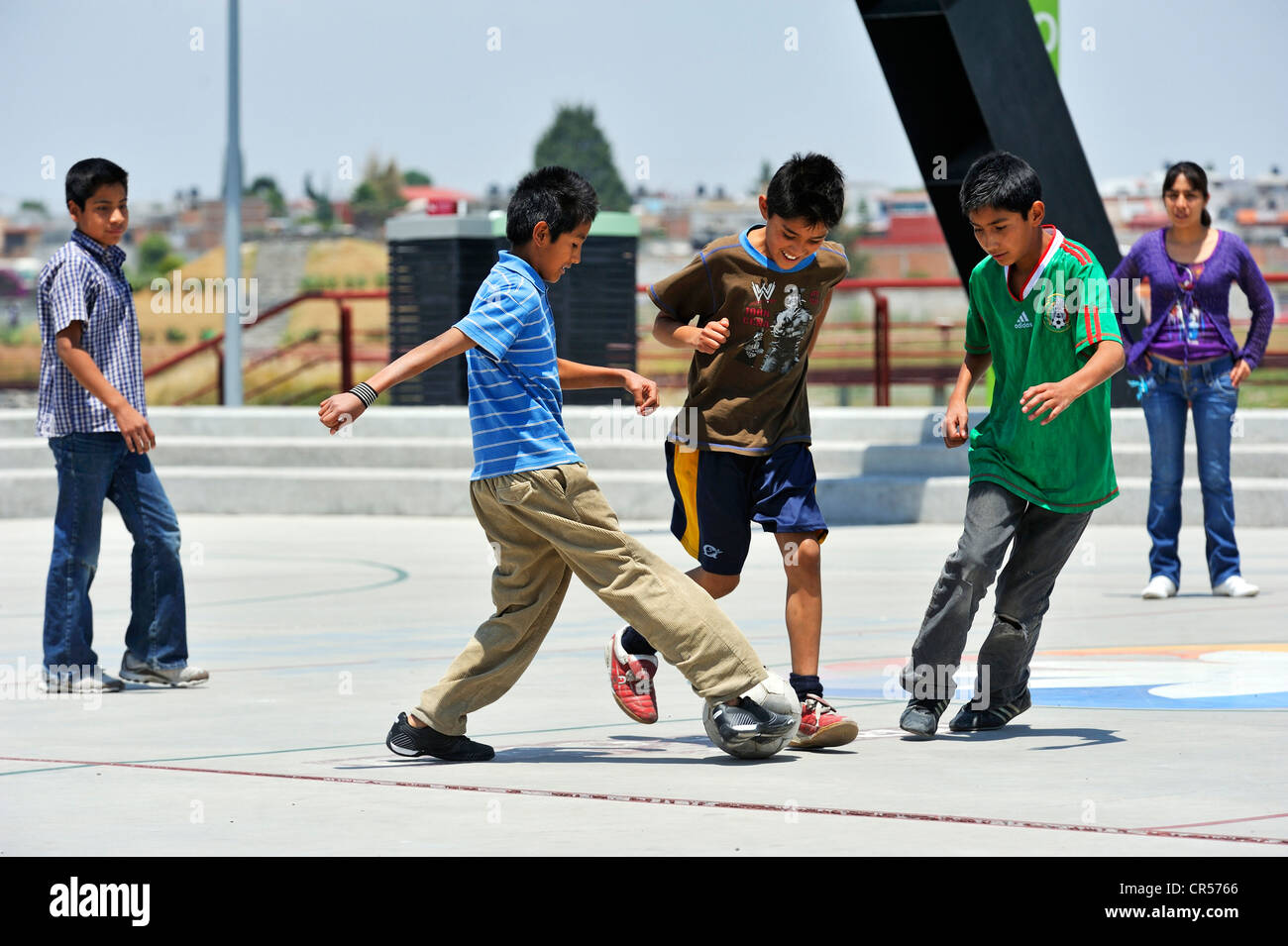 Young people playing football, Puebla, Mexico, North America, Latin America Stock Photo
